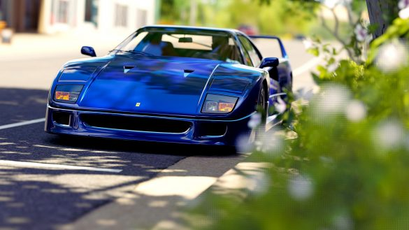 A blue car driving down a street