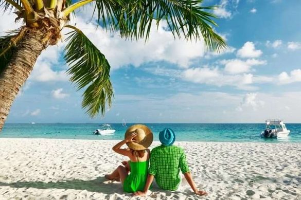 A couple sitting at beach