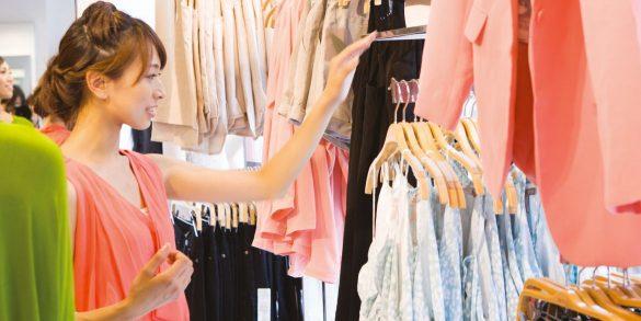 A girl choosing dresses