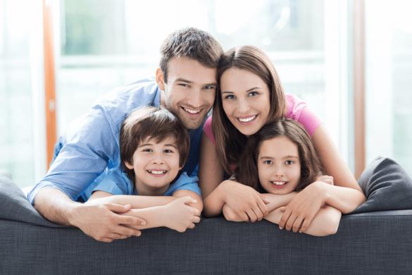 A couple and kids on a sofa
